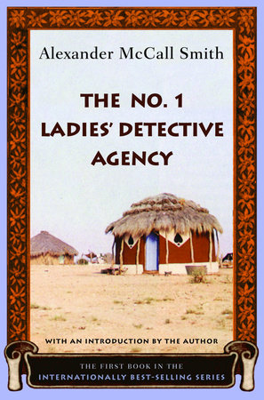 An orange and black floral border frames a photograph of a thatched African cottage on dry scrubby ground. The title and author appears against the pale blue sky. A scroll at the bottom announces that is an international best-selling series.