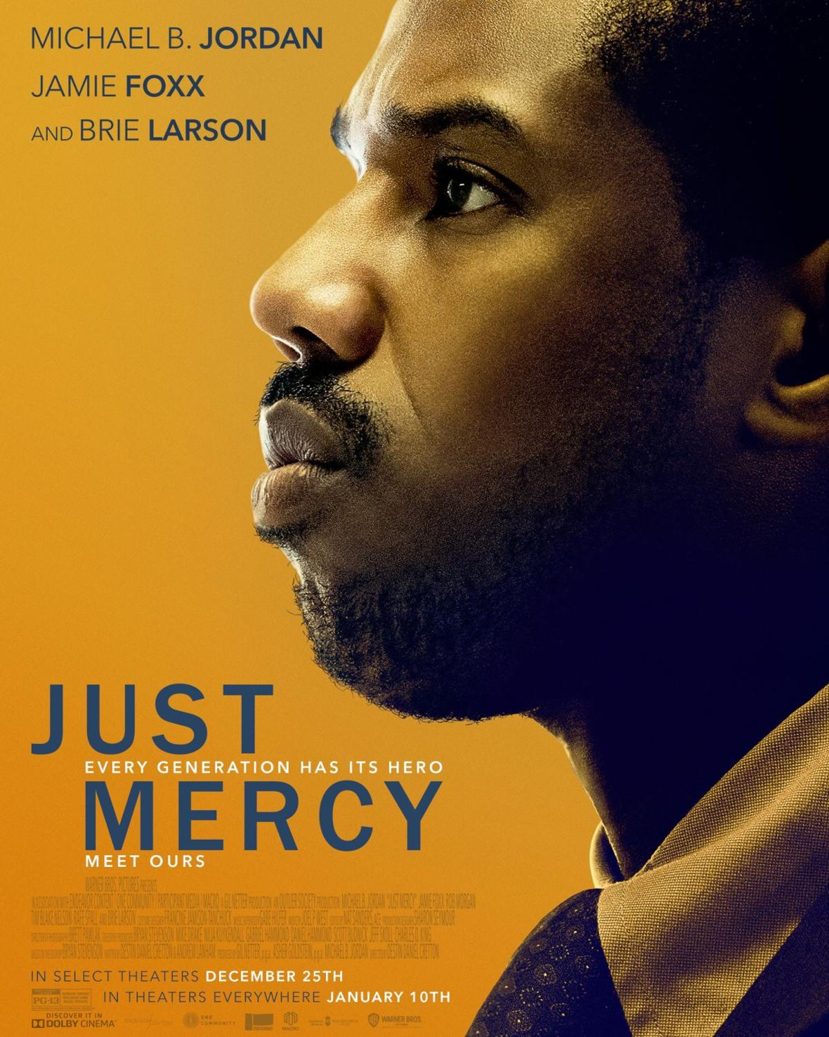 Michael B Jordan stands tall in a gray suit and blue shirt and tie, looking off into the distance.  Behind him, in muted yellow are scenes from the movie. Just Mercy is written in white, along with names of actors, Michael B Jordan, Jamie Foxx, and Brie Larson