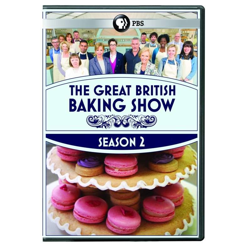 The Great British Baking Show DVD cover, with the contestants and hosts at the top and a tray of macaron cookies below.