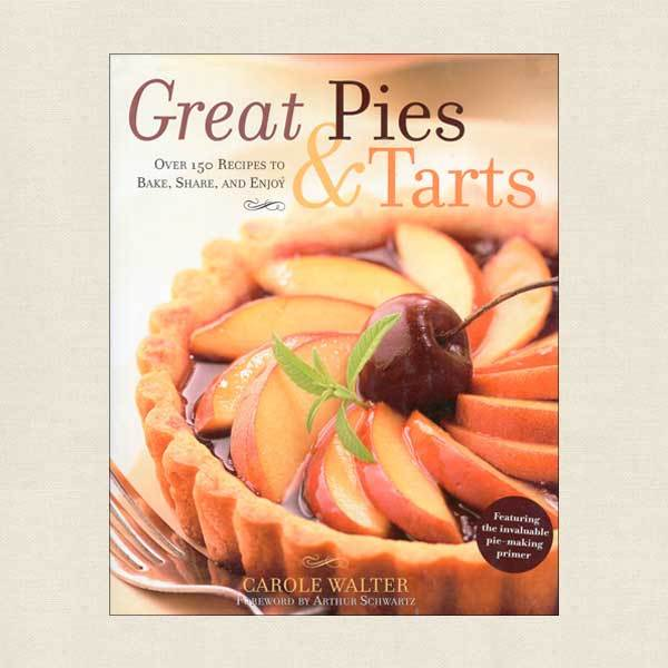 Cover of cookbook features a plum tart with luscious glossy fruit arranged in a swirl on a pastry shell, with a cherry in the middle.