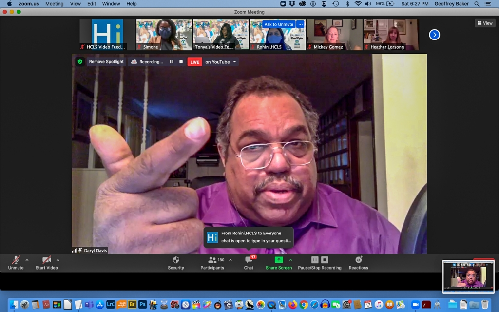 Screen shot from a Zoom meeting, with Daryl Davis gesturing toward the screen.