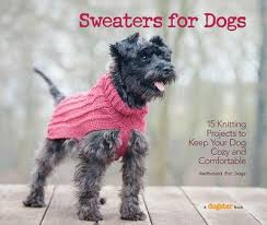 The book cover photograph depicts a dark grey terrier wearing a knitted pink sweater.