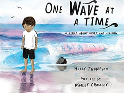 """The cover of """"One Wave at a Time"""" depicts a child in t-shirt and shorts with a sad expression, walking along the beach with the ocean and seagulls in the background."""