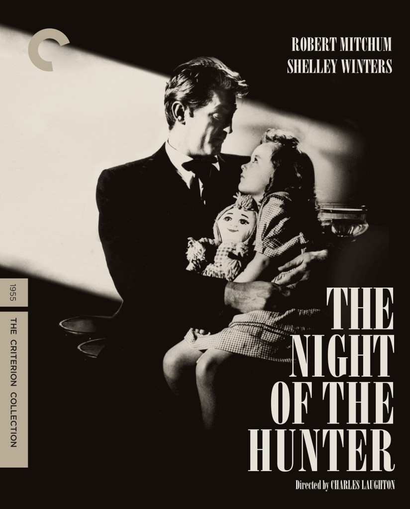 "The movie poster for ""The Night of the Hunter"" shows Robert Mitchum holding a small girl clutching a rag doll, with light streaming in to illuminate the pair in a dark room."