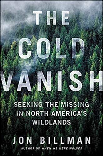 The book cover is an aerial photograph of a mountainous area covered in conifers, with a cloudy gray-white mist settled over the dark green of the treetops.