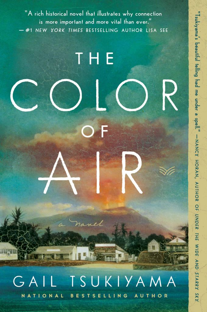 The book cover depicts the small town of Hilo at the shoreline, with buildings in shades of white and brown against a foreground and backdrop of turquoise sea and sky; in the distance, Mauna Loa is erupting into the sky, with yellow flame and reddish clouds above the silhouette of the mountain.
