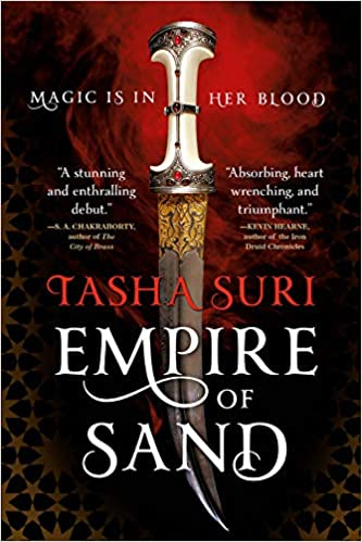 """An ornate curved dagger with a jeweled hilt appears against a swirling red background, with """"Magic is in her blood"""" at the top and Tasha Suri, Empire of Sand across it along the bottom."""