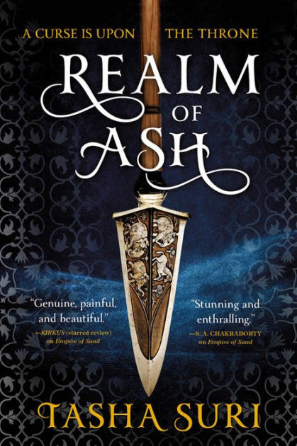 """A spear points downward against a patterned blue background, with """"A curse is upon the throne"""" in gold script above """"Realm of Ash"""" overlaying the spear, and """"Tasha Suri"""" at the bottom."""