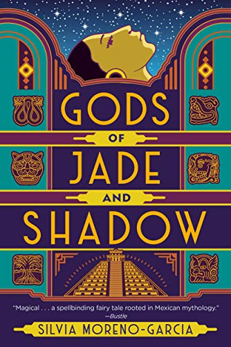 A colorful cover full of jade green, deep purple, and gold features the profile of a young Mexican woman gazing at the starys. The panels are decorated with Mayan symbols, including a double headed snake, a caiman, and a skull.