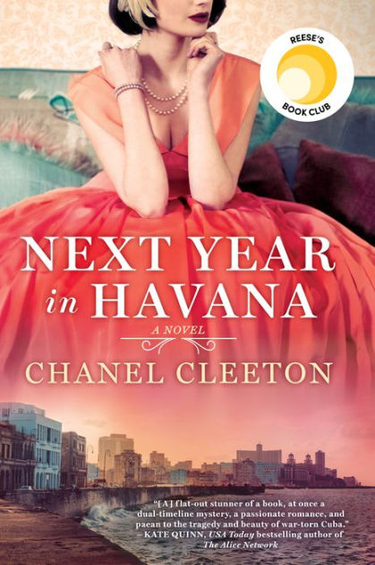 A dark haired young woman sits in a coral colored party dress. Her skirts fade into the skyline of Havana's seaside.