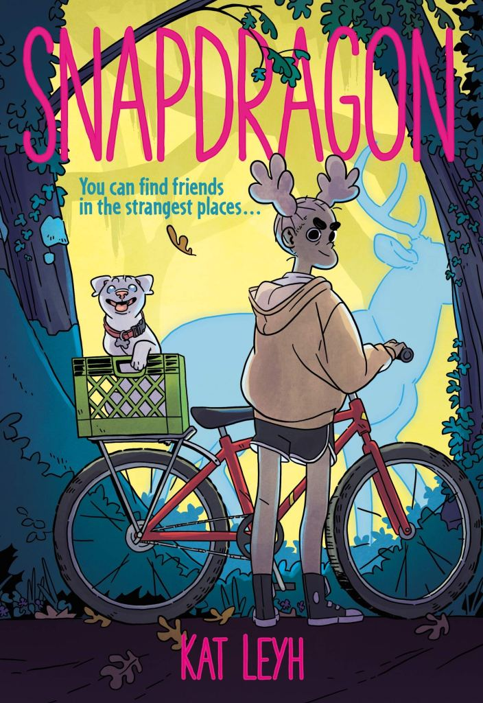 This image is of the cover of Snapdragon with the main character Snap and her bike and dog who is missing a leg in the basket atop the back of the bike. The background is a forest with a spirit of a buck behind Snap.