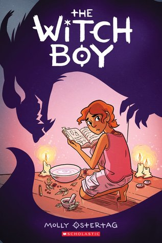This image shows the cover of The Witch Boy. Main character Aster reads a spell book over an altar made of liquid in a bowl, candles, and a mortar and pestle.